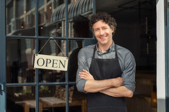 Portrait of small business owner smiling and standing with crossed arms outside the cafe. Portrait o (Mercantile Realty) Tags: apron business businessman cafe caucasian cheerful coffee coffeeshop confident crossedarms door entrance entrepreneur handsome happy lifestyle looking lookingatcamera man manager mature occupation open owner ownerstore people portrait profession professional proud proudman restaurant satisfied service shop sign small smallbusiness smiling staff standing store success successful waiter welcome work worker