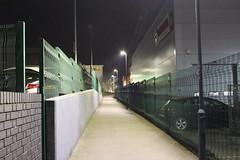 Night Shoot, 85 (doojohn701) Tags: path passage streetlighting cars fence green concrete buildings toyota brickwork dusk dark night sky cctv reflection shadow corner sidcup distance uk
