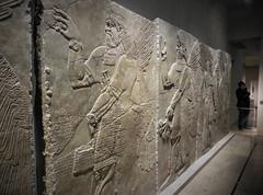 hands in action (SM Tham) Tags: europe germany bavaria munich statemuseumofegyptianart sumerian assyrian art stone wallpanels gods guardians winged display lighting