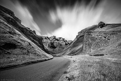 The Pass (Through_Urizen) Tags: category derbyshire england landscape places winnatspass canon1585mm canon canon70d monochrome mono blackandwhite bw whiteandblack grey clouds motionblur longexposure sky grass rocks cliff gorge hills tree trees