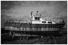 The Prim Glara (f_gray1) Tags: boat derelic ship sea docks dockside neglected grimsby monochrome prim glara sky clouds grass wood