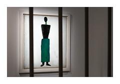 Woman behind bars (Marcello Arduini) Tags: exhibition avantgarde russian silohuette bars grainy prison
