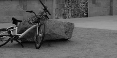 The Wailing Wall (Rand Luv'n Life) Tags: odc our daily challenge balanced photography outdoor composition bicycles rock boulder wall art spokes sparks blocks conrete monochrome blackandwhite abandon poetry balance