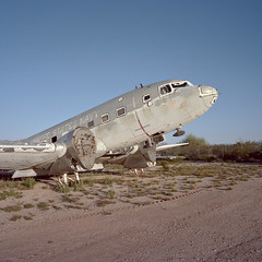 wanting to fly. tucson, az. 2015. (eyetwist) Tags: eyetwistkevinballuff eyetwist nose cockpit douglas r4d skytrain navy c47 dc3 dakota tucson usn arizona boneyard airplane mamiya 6mf 50mm kodak portra 160 mamiya6mf mamiya50mmf4l film ishootfilm 6x6 analog desert urbex graveyard aircraft planes analogue emulsion mamiya6 square 120 filmexif epsonv750pro filmtagger ishootkodak americantypologies southwest usa junkyard scrap junk decay derelict abandoned rusty scrapped transport ww2 old superdc3 c117 gooneybird faded patina wings shredder recycled gone american west amarc amarg iconla sunset