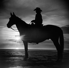 Holme Beach 2 (so last century) Tags: film ilfordhp5 ilfordfilm yashica635 bw blackandwhite beach americana analog western horse horseback holmebeach homefarmstables hunstanton countrymusic
