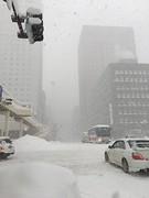 Snow Disguised as Fog (sjrankin) Tags: 11january2019 edited sapporo hokkaido japan snow clouds winter roa cars buildings skyline city