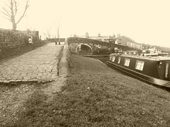 Bridge to Marple wharf  (Peak Forest Canal)   February 2019 (dave_attrill) Tags: marplejunction toplock marina wharf bridge macclesfieldcanal barges moored peakforest canal towpath peakdistrict nationalpark cheshire february 2019 cheshirering sepia monochrome tint water waterway