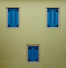 Broken Symmetry (Rupert Brun) Tags: 2017 greece holiday ionian island ithaca mediterranean september summer ithaki ionianislands gr broken symmetry shutters blue yellow wall 3 three