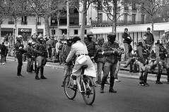 the white coat (Franck gallery) Tags: noirblanc blackwhite girl woman cycle vélo femme fille police arme gun protestation manifestation paris giletsjaunes yellowvest d90