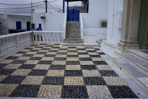 Pebble mosaic and blue gate, Church of the Holy Trinity and St. John, Falatados, Tinos