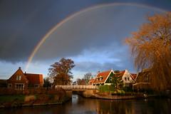 Winter rainbow (Julysha) Tags: rainbow rain weather acr thenetherlands noordholland derijp bridge canal 2019 sky village winter december d850 sigma241054art tree sunset evening