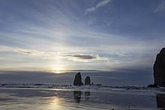 Sunset Ray (HK Passey) Tags: sunset sky cannonbeach ocean beach rocks seastacks