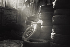 Tired tires... (Lorre_1) Tags: tire piles bw blackandwhite outdoor canon 30mm sweden stockholm sunlight
