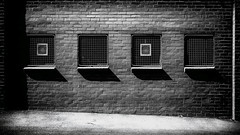 Little boxes (Chas56) Tags: wall windows geometry bricks canon canon5dmkiii four shadows light melbourne monochrome blackwhite