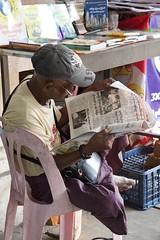 le repos du marchand de journaux - rest of the shopkeeper (Patrick Doreau) Tags: myanmar birmanie rangoon yangoon burma birman repos journaux newspaper lecture reading chaise downtown centreville rue shopkeeper street pâli rest