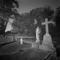In a Cemetery, Bolinas, California, New Year's Day (austin granger) Tags: bolinas northerncalifornia cemetery angel grave death cross religion film pinhole woodbläk rays trix newyearsday