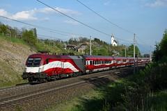 """1116 249, rj 110 """"Hohe Tauern"""" ( Klagenfurt > München ). Mühldorf-Möllbrücke (M. Kolenig) Tags: 1116 fahne railjet tauernbahn kirche baum wolken"""