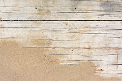 Sand on planked wood. Summer background with copy space. Top view (VFDLVXNQNAZFALM5XK35INB5TU) Tags: sand wood beach background texture flat view top old surface pattern board summer vacation path vintage space copyspace travel retro decorative plank empty above table rough panel weathered italy
