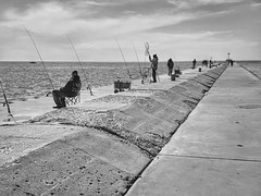 Fishing (mswan777) Tags: michigan stjoseph cement mobile iphone iphoneography apple white ansel black monochrome water spring fishing cloud sky outdoor coast shore seascape pier