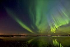 Green jet 10:55 leprechaun (John Andersen (JPAndersen images)) Tags: alberta aurora beiseker green night pond reflections