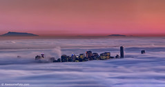 Heaven at twilight (james c. (vancouver bc)) Tags: smooth flow underneath light mountain fairyland heavenly heaven sunsetglow misty foggy purple pink ocean blue structure landmark vancouver downtown building britishcolumbia attraction canada inlet modern travel urban landscape glow mist winter color colorful colour aerial metropolis skyscraper greatervancouver fog bc city night sea sky skyline twilight