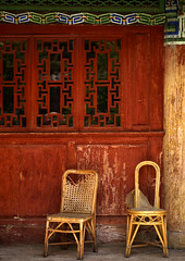 Chairs In Front Of An Old House, Lijiang, Yunnan Province, China (Eric Lafforgue) Tags: a7574 absence ancient architecture asia buildingexterior china chineseculture colorpicture house lijiang nopeople outdoors red tranquility vertical window yunnan yunnanprovince