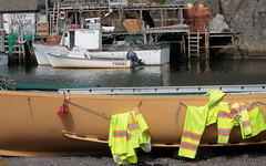 Twas A Wet Day On The Seas (peterkelly) Tags: digital canon 6d northamerica canada newfoundlandlabrador stjohns quidividi harbor harbour water boat fishing dock ship nets ladder floats waterproof pants jacket outboard engine cliff rock