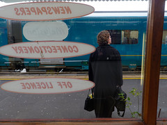 to Swansea (watcher330) Tags: carmarthen woman train cafe window