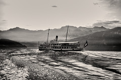 Under steam (Zoom58.9) Tags: ship sea water waves oldtimer landscape nature mountains sky clouds fog width monochrome bw europe switzerland schiff see wasser wellen landschaft natur berge himmel wolken nebel weite sw europa schweiz canon eos 50d luzern alps