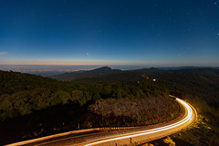 Morning twilight sky over Chiang Mai Province with traffic light trails in the mountain road of Doi Inthanon. (baddoguy) Tags: aerial view blue chiang mai province copy space country road curve dawn directional sign dusk famous place horizon over land horizontal journey vehicle light trail line art long exposure morning mountain national landmark night photography point rural scene speed star sunrise thailand tourism transportation travel destinations twilight