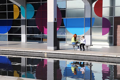 Shapes and colours (smir_001) Tags: bristol england millenniumsquare wethecurious bbcbigscreen explore city westcountry unitedkingdom building architecture people candid shapes forms pink blue white yellow rose bench lunch lunchtime february winter center centre attraction tourist water reflections colourful modernarchitecture modern contemporarily art