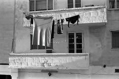 On the Line  (Delta 400) (Harald Philipp) Tags: malta sliema clothesline kodakretina retinaiiic monochrome bw blackandwhite film analog analogue 135 rangefinder foldingcamera street alley clothes
