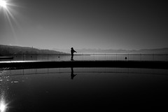 Fisherman (maekke) Tags: zürich tiefenbrunnen badi zürichsee reflection streetphotography fisher fisherman 35mm fujifilm x100f bw noiretblanc ch switzerland 2019 alps silhouette