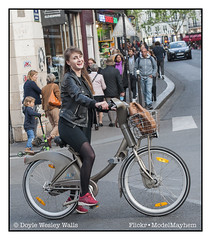 Beautiful Girl on a Bicycle in Paris, Who Smiled at Me when She Saw Me Raise My Camera to My Eye (Doyle Wesley Walls) Tags: 0657 woman girl female bike bicycle paris beautiful pedestrians car doylewesleywalls