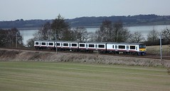 On the Harwich Branch (Chris Baines) Tags: ga 321 four car set approaching nether hall 1500 service fr om manningtree harwich town stour estuary background