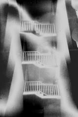 gradient (BleakView) Tags: gradient bleak bleakview blackandwhite bw grain filmgrain filmerror mirage lucid dream urban postapocalyptic postpunk exposure prism pictorialism stairs industrial urbex underground junkie ghost haunted bizzare