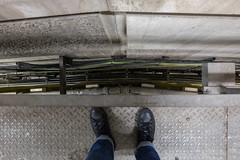 The 'concrete room' at the Barbican (Spannarama) Tags: concrete textures brutalist modernist architecture barbican london uk pipes cables backstagetour barbicanbackstagetour legs feet jeans converse lookingdown