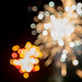 Fireworks on New Year's Eve with white, red and green lights in bokeh effect
