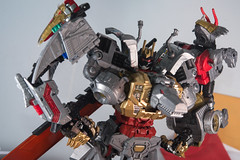DSC_9096 (Quantum Stalker) Tags: transformers takara hasbro power primes dinobots volcanicus transform dreamwave tdw upgrade kit thigh claws gold primal qc average sword weapons
