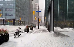 City biker (Hakon07) Tags: citybiker downtown winter street road snow snowstorm bicycle buildings building architecture sign lights