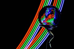 Rainbow Refraction (Karen_Chappell) Tags: rgb red green blue black glass ball orb sphere refraction curve arc curves shape circle stilllife led lightpainting longexposure lines colourful multicoloured colours colour