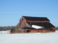 A big old red barn in North Gower (Ottawa), Ontario (Ullysses) Tags: northgower ottawa ontario canada snow neige winter hiver oldredbarn barn grange red rouge farm ferme goulbourn ashton