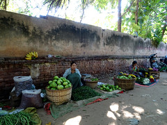 Waiting for a sale at the back of the Mani Sithu market in Nyaung U, Myanmar (Claire Backhouse) Tags: myanmar burma bagan culture market markets street streetphotography life living people vegetables organic agriculture horticulture growing fresh fruit waiting slow burmese baskets