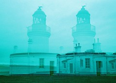 Double Lighthouse, Chanonry Point, March 2016 (Mano Green) Tags: lighthouse chanonry point fortrose rosemarkie black isle scotland uk double exposure coast sea march 2016 winter sky clouds light surreal multiple 40mm lens lomochrome purple 35mm film canon eos 300