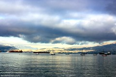 Burrard Inlet Sunrise (gerry.bates) Tags: kitsilanopark kitsbeach vancouver bc canada winter snow sunrise water burrardinlet ocean freighters boats sailingboats yachts mountains northshoremountains coastal clouds sky weather