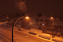"""And the snow covers my footprints, deep regrets, and heavy heartbeats..."" ~Ian Anderson (annapolis_rose) Tags: fraserstreetneighbourhood snow snowing snowcoveredground winter night streetlamp vancouver quote"