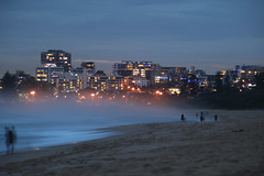 Sun setting on North Beach, Wollongong (RossCunningham183) Tags: mist seamist sunset beach sand ocean lights newyearseve wollongong nsw australia waves skyline sea building city