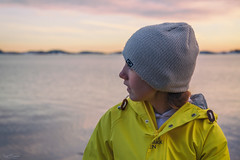 Just Sitting Here by the Sea (Kurt Evensen) Tags: norway hat girl winter sea gazing water tønsberg sky seascape weather yellow vestfold shore