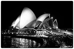 Opera House in B&W (Bob Shrader) Tags: olympuspenf olympusmzuikodigitaled12100mmf40ispro 28mm f4 1sec 800iso raw microfourthirds mft m43 mirrorless landmarks publicbuilding sydneyoperahouse nature water harbor sydneyharbor night sky lights oceania australia newsouthwales sydney penf zoomlens olympusmzuikodigital12100mmf40ispro outdoors exterior wideshot on1 photoraw2019 preset film 400fujineopan blackandwhite bw blackwhite monochrome fauxfilm photoborder photoedge photoframe postprocessing