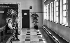 'Mind Blown' (Canadapt) Tags: woman seated foyer windows poster fireworks tile floor door plant bw lisbon portugal canadapt